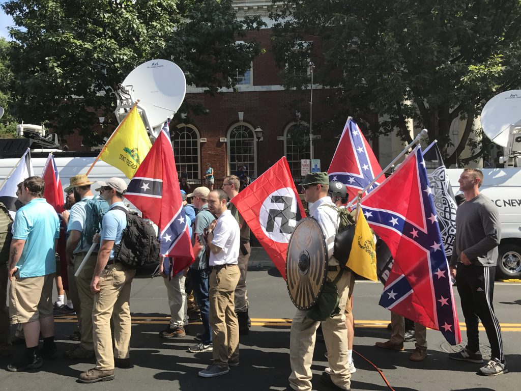 "Protestors carrying Nazi and Confederate flags at the Charlottesville ""Unite the Right"" rally"